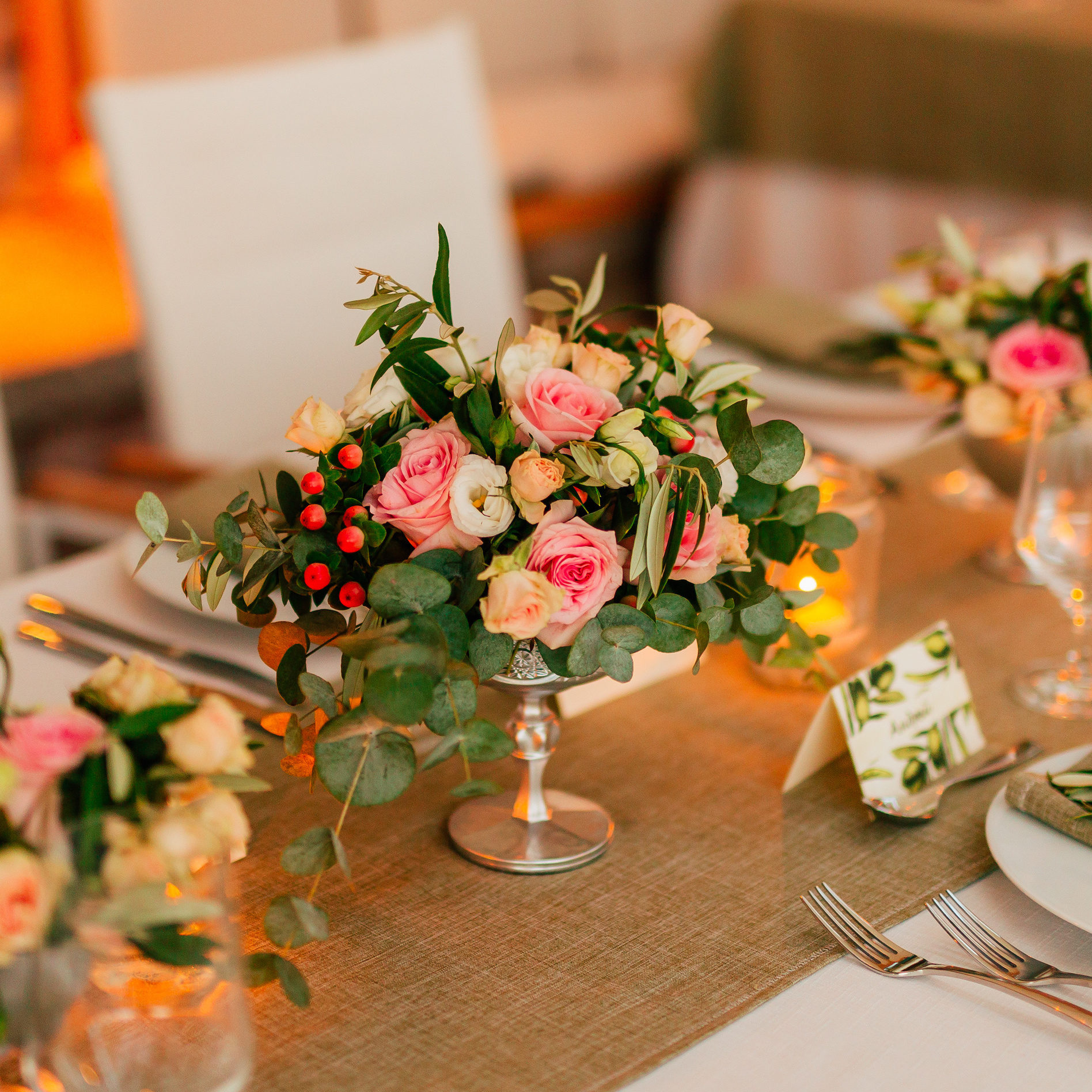Flower compositions on the wedding table in rustic style. Wedding decorations with their own hands. Wedding in Montenegro.